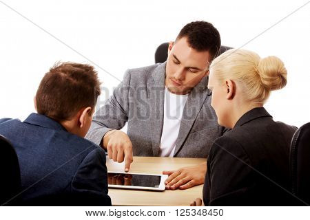 Businessman showing to people something on tablet