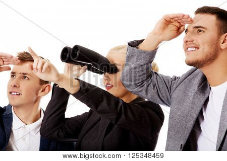Business team looking into one direction-woman using binoculars