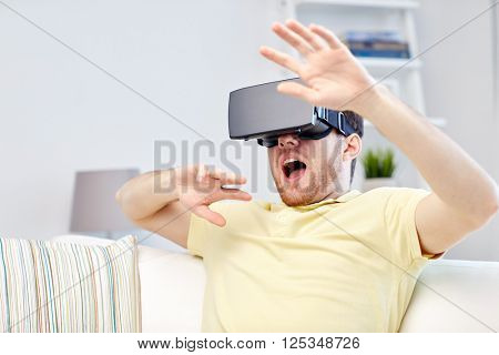3d technology, virtual reality, gaming, entertainment and people concept - scared young man with virtual reality headset or 3d glasses playing game