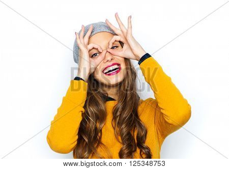 people, style and fashion concept - happy young woman or teen girl in casual clothes and hipster hat having fun