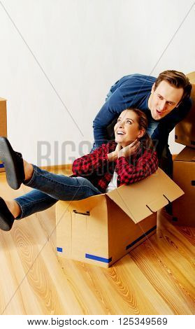Happy couple having fun in new home