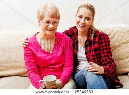 Mother with adult daughter watching comedy