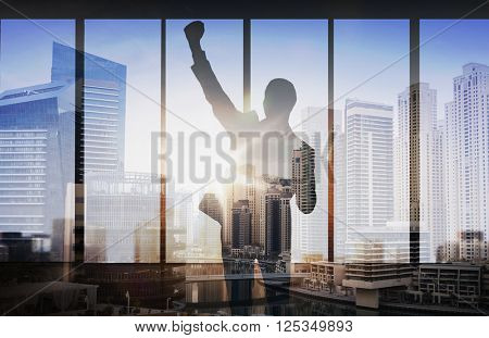 business, success, gesture and people concept - silhouette of happy businessman raising fist and celebrating victory over double exposure office and city background