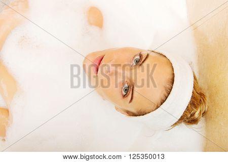 Young woman relaxing in bath