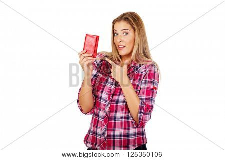 Young woman holding wallet and pointing on them
