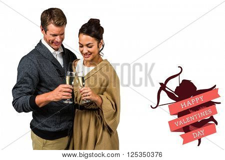Happy couple holding wine glasses against cute valentines message