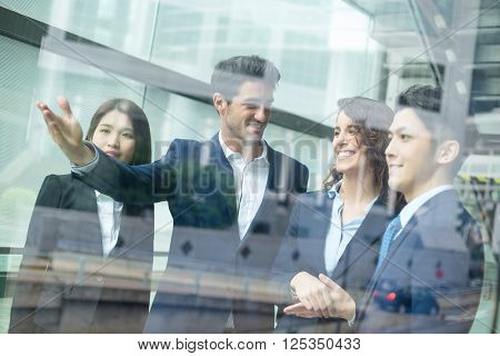 Group of business people discuss inside office