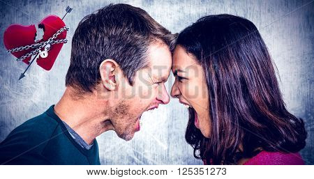 Couple yelling while standing head to head against locked heart