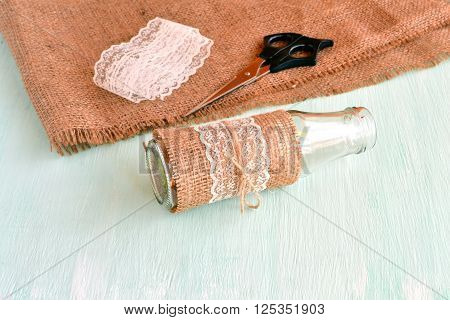 Empty vase, scissors, burlap, lace. Set for handmade vase