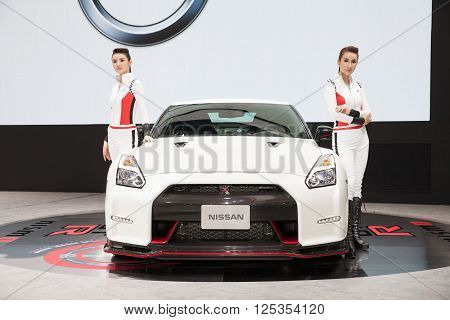 BANGKOK - MARCH 22: Nissan GTR car with Unidentified models on display at The 37 th Thailand Bangkok International Motor Show on March 22 2016 in Bangkok Thailand.