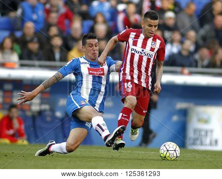 BARCELONA - APRIL, 9: Enzo Roco(L) of RCD Espanyol and Angel Correa(R) of Atletico Madrid during a Spanish League match at the Power8 stadium on April 9, 2016 in Barcelona, Spain