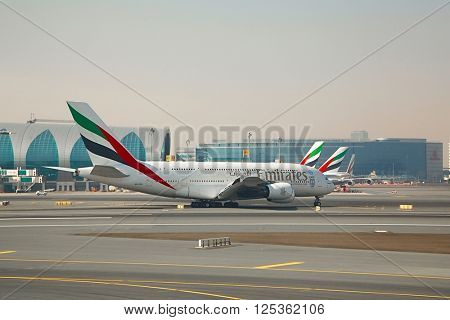 DUBAI, UNITED ARAB EMIRATES - APRIL 5: Emirates Airbus A380 taxiing at Dubai International Airport, April 5th, 2016. The Airbus A380 is the largest passenger aircraft.