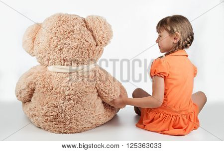 Child playing with a plush toy soft toy. Funny baby with a soft toy . Layout for social projects