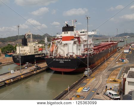 PANAMA - MARCH 21: Ship in Miraflores Locks Panama Canal, electric locomotives pull ships in transit, March 21, 2016 in Panama