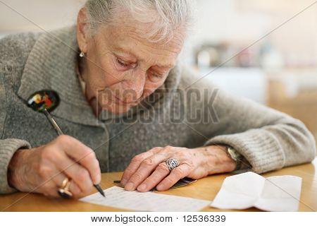 Senior lady writing