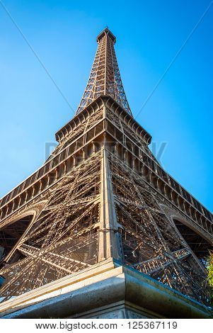 Detail of Eiffel tower in afteroon sun. Tower was designed by Gustave Eiffel and Stephen Sauvestre in 1889.