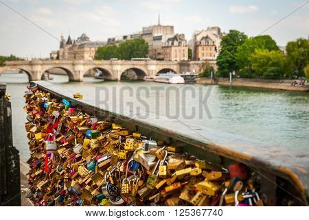 PARIS, FRANCE - JUNE 9: Padlocks on the bridge of Ponts de Arts in Paris France. June 2015