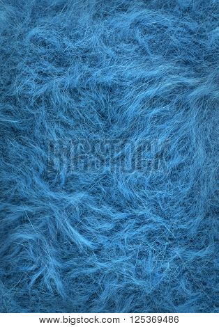 fleecy soft texture of angora. fleecy woolen fabric for the background.