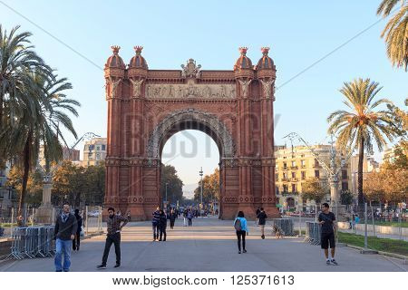 Barcelona, Spain - November 11, 2015: Triumphal arch Arc de Triomf and promenade Passeig de Lluis Companys. The arch was built as the main access gate for the 1888 Barcelona World Fair by architect Josep Vilaseca i Casanovas.