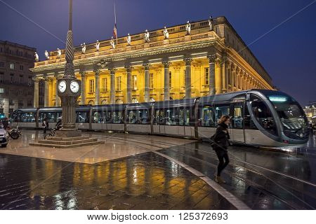 Bordeaux France - March 25 2016. Tram rolling near to Grand Theatre de Bordeaux at night. The theatre is home to the Opera National de Bordeaux and the Ballet National de Bordeaux. Bordeaux Aquitaine. France.