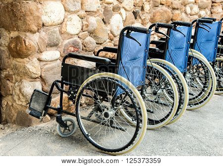 Wheelchairs Wheel chairs parked cars lineSide shooting.
