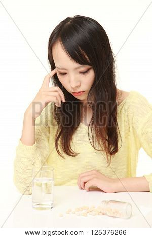 portrait of young Japanese woman suffers from melancholy