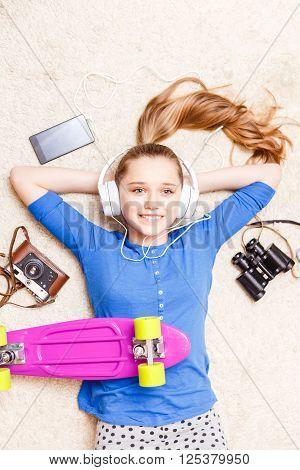 Dreaming Cheerful Teenage Girl Lying On The Floor