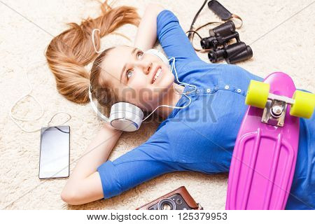 Dreaming Cheerful Teenage Girl Lying On The Floor