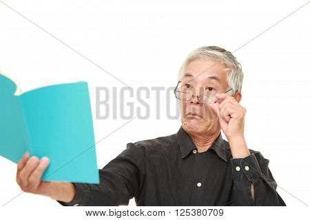 portrait of senior Japanese man with presbyopia