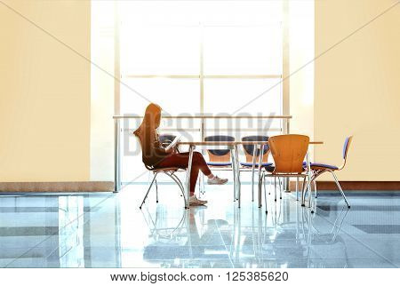 Pretty young student girl studying in the university. Education conceptual image.