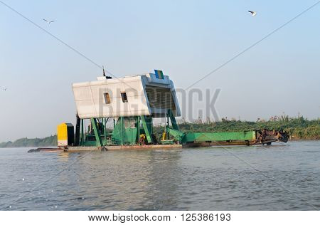 Dredging Machine On A Platform Along A River