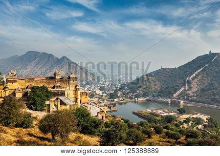 Indian travel famous tourist landmark - view of Amer (Amber) fort and Maota lake, Rajasthan, India poster