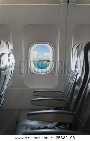 View From A Commercial Airplane  Cabin, Showing Blue Sky, Holiday Destination And A Row Of Comfortab