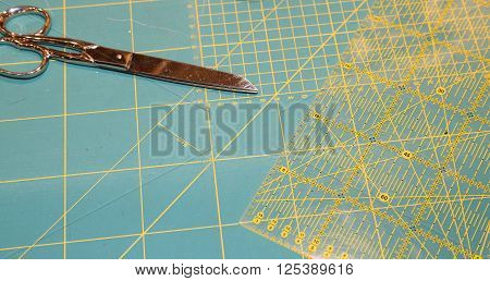 Large Tailor's Scissors On The Worktop With Millimeter Scale Background