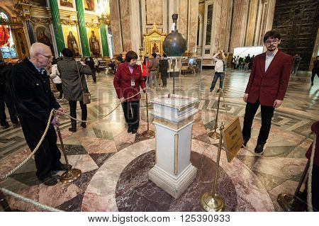 Saint-Petersburg Russia - April 12 2016: Public demonstration of the Foucault pendulum in St. Isaac's Cathedral. The pendulum was installed in 1932 to demonstrate the rotation of the Earth.