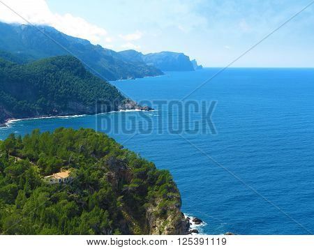 house in coastal mediterranean landscape with overlook over the sea