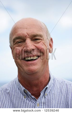 Portrait of a senior man laughing poster