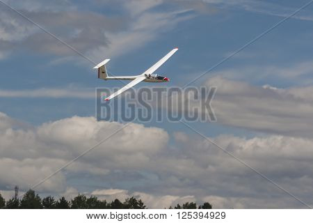 Minsk Belarus-June 21 2014: Glider in Air During Aviation Sport Event Dedicated to the 80th Anniversary of DOSAAF Foundation in Minsk on June 21 2014 in Minsk Republic of Belarus