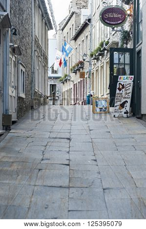QUEBEC CITY/ CANADA - JUNE 12 2010: Narrow alley leading to shops in Quebec City's Lower Town