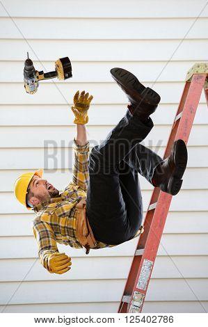 Worker falling from ladder inside room