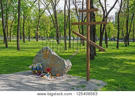 Dnepropetrovsk Ukraine - April 24 2014: Cross and memorial stone in honor of the lost
