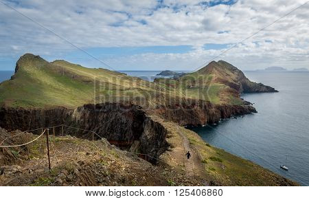 Traveler woman doing her hike at Madeira island eastern trail route. Beautiful landscapes of Madeira, Portugal.