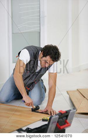 Man laying parquet