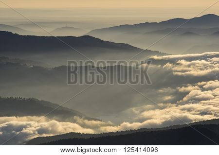 Low altitude clouds over the misty mountains.