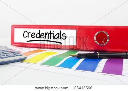 Word credentials underlined against business desk with documents