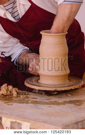 Potter Modelling A Clay Vase