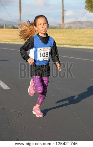 Menifee California USA/April 9 2016:Photo of runner running in the Menifee Half Marathon & 5K