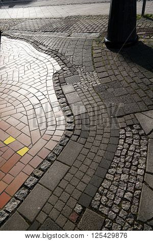 Footpath in the center of Magdeburg with various cobblestones