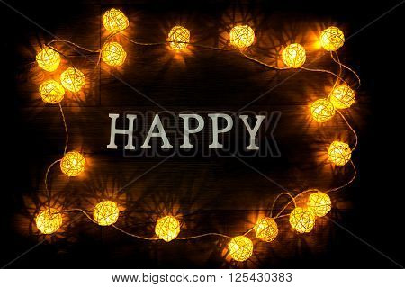 Happy -  plain paper letters on woodden background