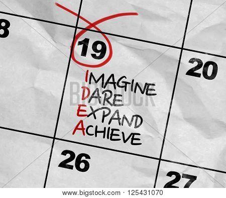 Concept image of a Calendar with the text: IDEA - Imagine, Dare, Expand, Achieve